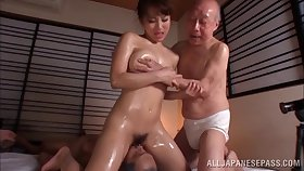 Oiled Japanese model fucked by two guys at the same time - Mao Kurata